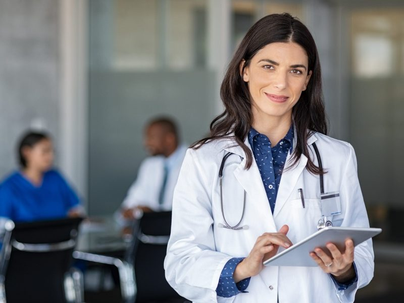 Woman Doctor holding tablet with stethoscope around her neck Medical Translation Translation Solutions, San Diego