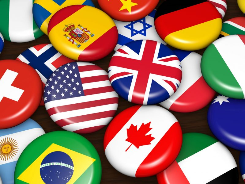 Multi-colored flags from countries from all around the world United States English Spanish French German Italian Portuguese Translation Solutions, Global Translations, Provider, International Marketing, San Diego, Call (858) 613-0936